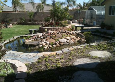 Pond, flagstone, raised planters, sod, sprinkler